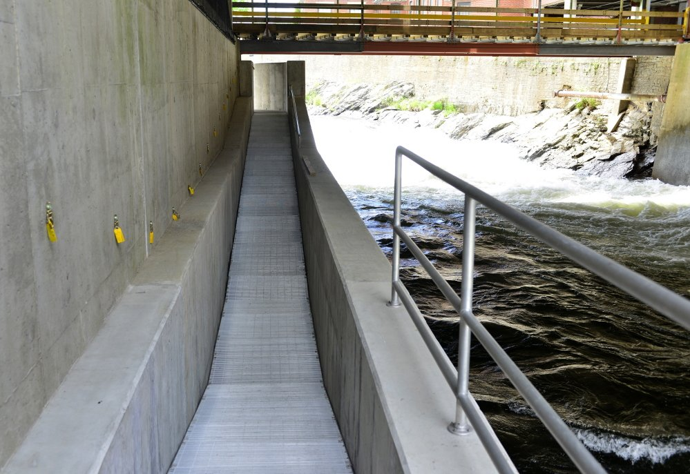 Photos by Logan Werlinger/Staff Photographer Sappi Fine Paper in Westbrook, ordered in 2009 to build a fish passage by Inland Fisheries and Wildlife, completed the structure at Cumberland Mills Dam in April of last year.