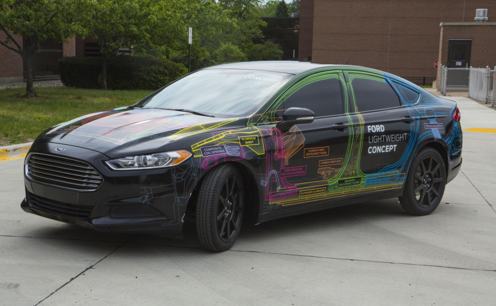 The Associated Press This undated photo provided by Ford Motor Co. shows a lightweight Fusion sedan that was unveiled last week. The prototype is 800 pounds lighter than a regular Fusion thanks to more use of aluminum and other materials.