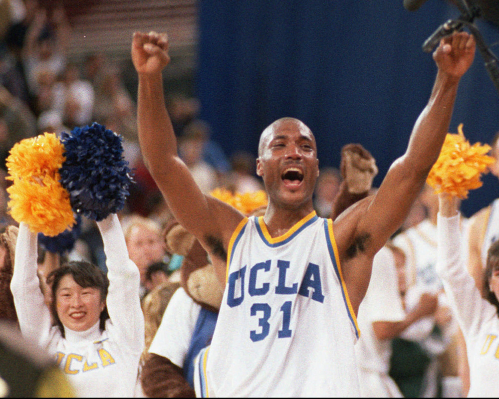 In this April 1995 file photo, UCLA's Ed O'Bannon celebrates after his team won the NCAA championship game against Arkansas in Seattle. Five years after the former UCLA star filed his antitrust lawsuit against the NCAA, it went to trial Monday, June 9, 2014. The Associated Press/Eric Draper