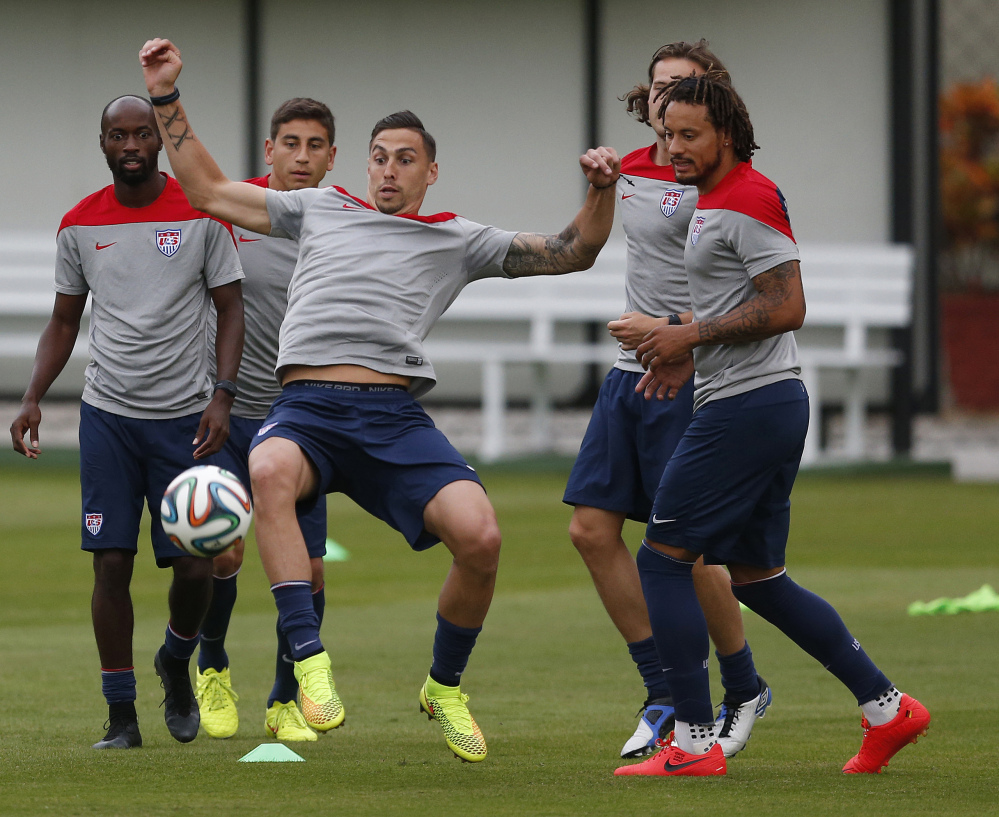 The Associated Press United States' Geoff Cameron keeps a ball in the air during a drill with teammates at the Sao Paulo FC training center in Brazil on Monday. The U.S. will begin play on June 16.
