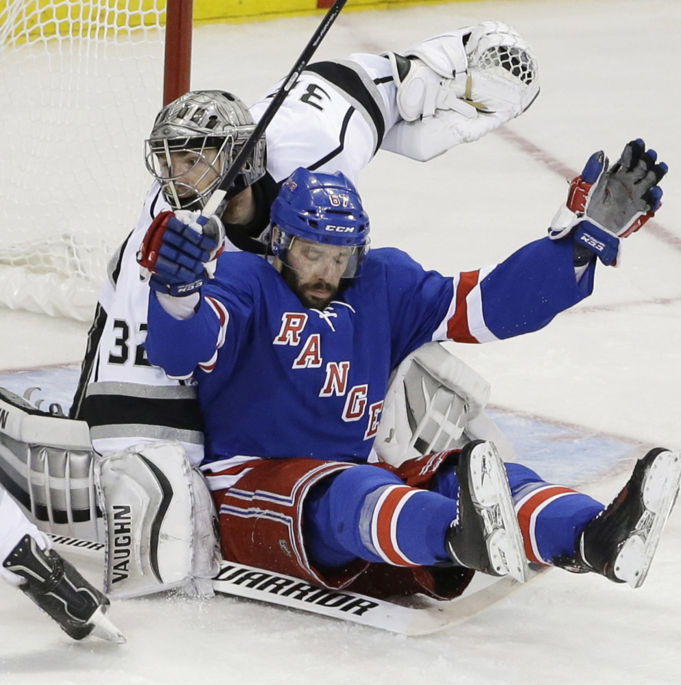 New York Rangers right wing Martin St. Louis, right, falls back into Los Angeles Kings goalie Jonathan Quick in the second period of Game 3 of the Stanley Cup Monday at New York. Quick made 32 saves as the Kings won 3-0. The Associated Press