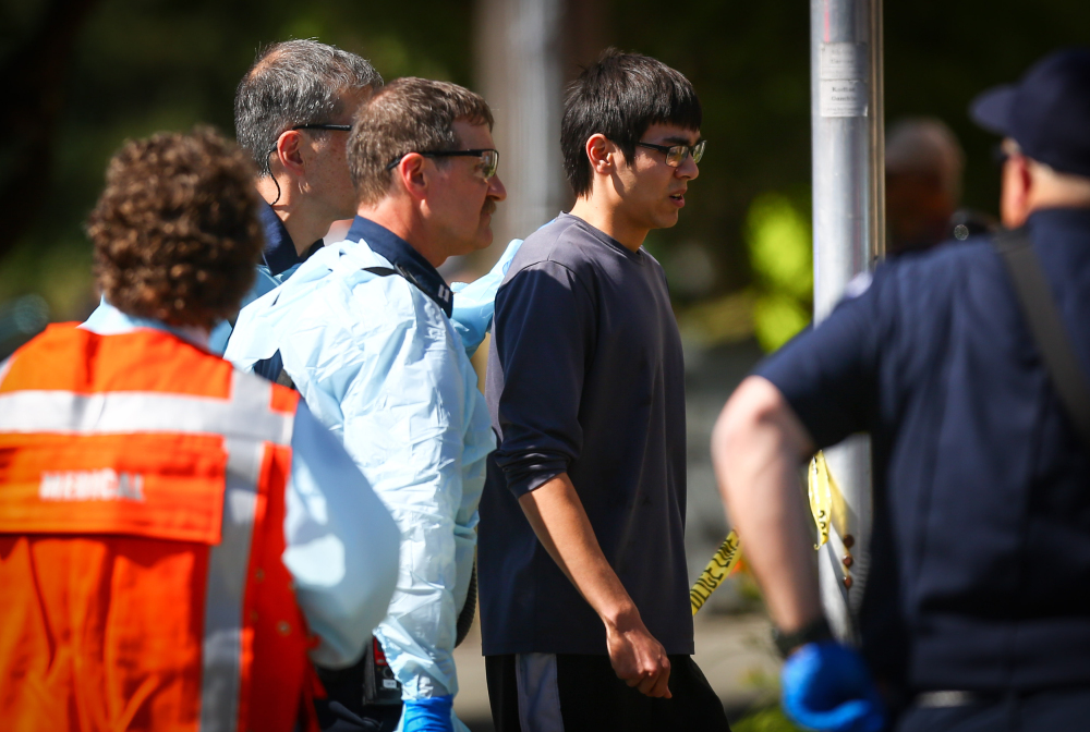 Jon Meis is taken from the scene by medics after he pepper sprayed and tackled a shooting suspect at Seattle Pacific University in Seattle on June 5.