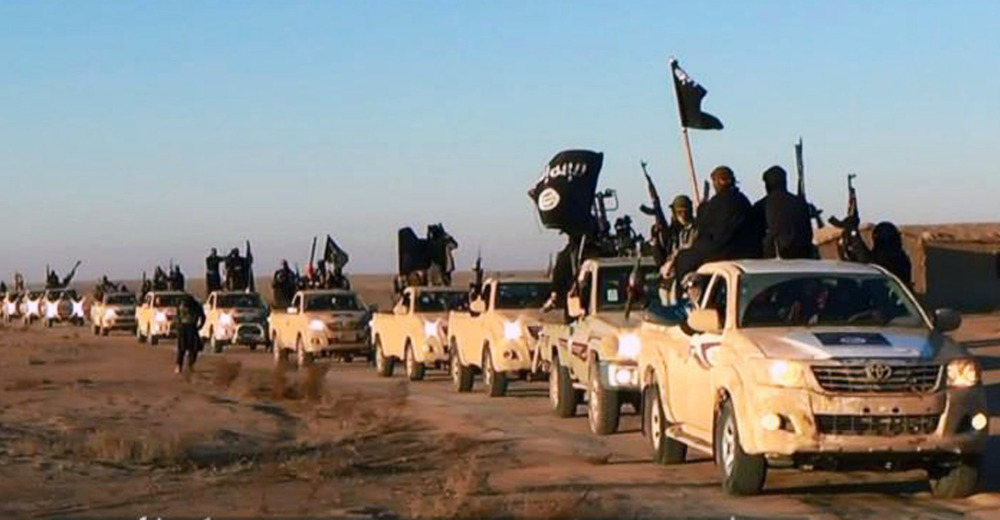 This file image posted on a militant website in January 2014, which is consistent with AP reporting, shows a convoy of vehicles and fighters from the former al-Qaida affiliate Islamic State of Iraq and the Levant in Iraq's Anbar Province.