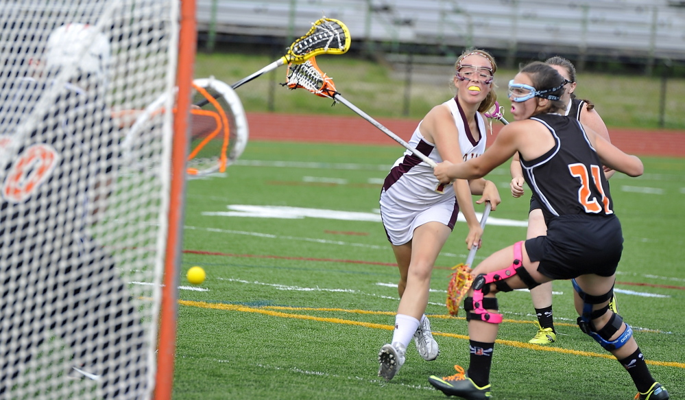 Thornton Academy's Valerie Pendleton gets a shot through the Biddeford defense to score a goal during the Trojans' 5-1 win on Wednesday.