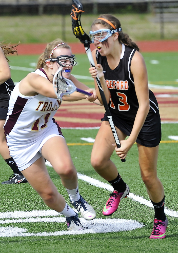 Melissa Huot, right, of Biddeford tries to get past the defense of Tatum Leclair of Thornton Academy during the Trojans' 5-1 win on Wednesday.