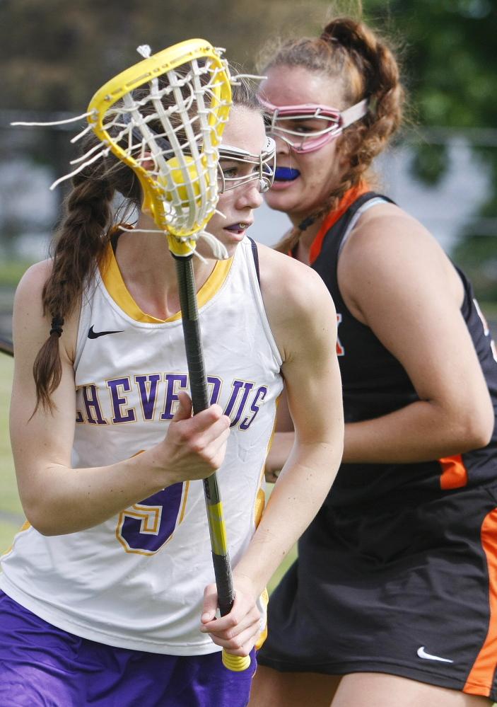 Meredith Willard, left, of Cheverus looks for a pass with Sasha Hampton of Brunswick defending. Cheverus won the game 20-5.