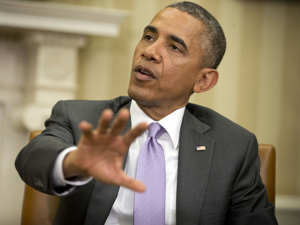 """President Barack Obama answers questions on violence in Iraq during his meeting with Australian Prime Minister Tony Abbott: """"We do have a stake in making sure that these jihadists are not getting a permanent foothold in either Iraq, or Syria, for that matter."""""""