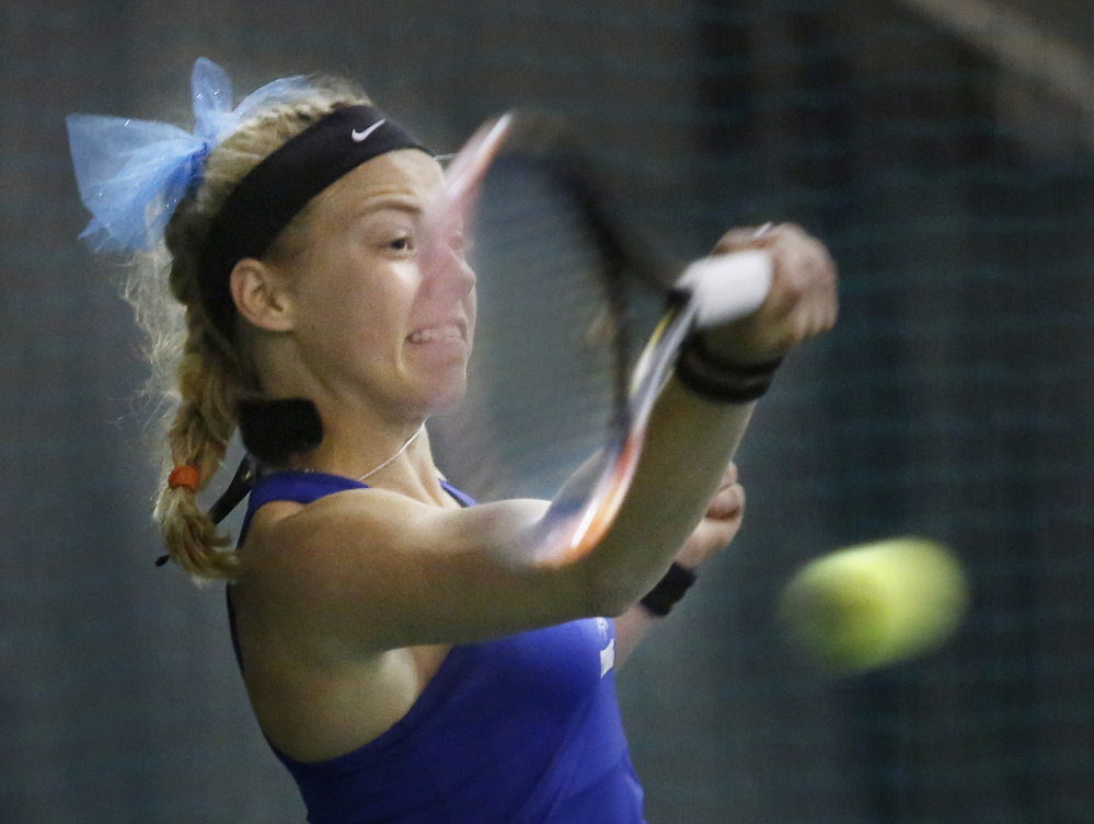 Olivia Leavitt of Falmouth, the state singles champ, returns a shot Thursday during the win over Portland in the Western Class A final. The Yachtsmen, who have won 108 straight matches, meet Brunswick for the state title.