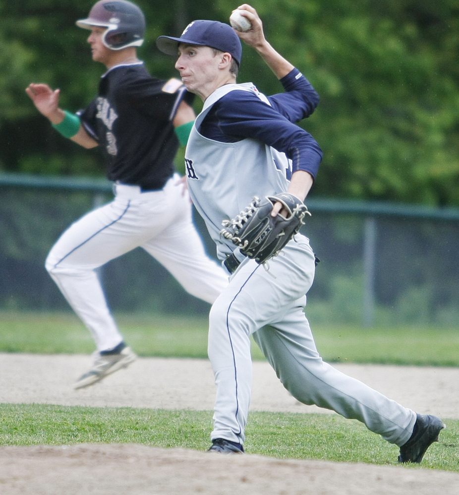 Yarmouth third baseman Connor Lainey throws home for the out as Greely's Austin Nowinski runs to third during Greely's Western B quarterfinal win on Thursday in Cumberland.