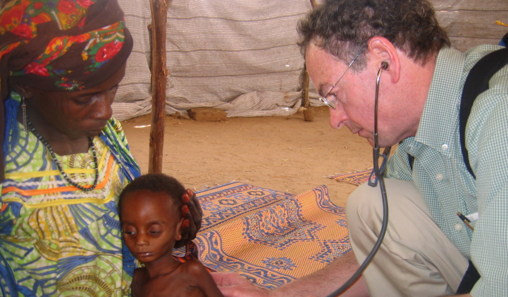 Richard Rockefeller treats a Nigerian child during a meningitis outbreak. Rockefeller died Friday in a plane crash in Westchester County, N.Y., on his way to Portland.