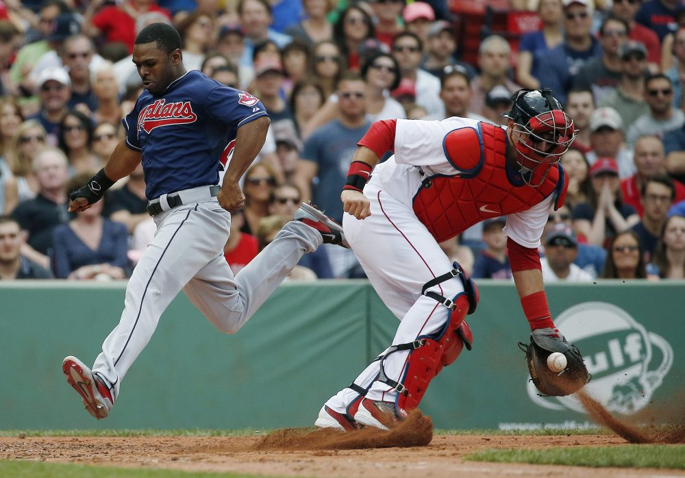 Michael Bourn of the Cleveland Indians scores as Red Sox catcher A.J. Pierzynski gets the throw on a double hit by Asdrubal Cabrera in the third inning at Fenway Park in Boston on Saturday.