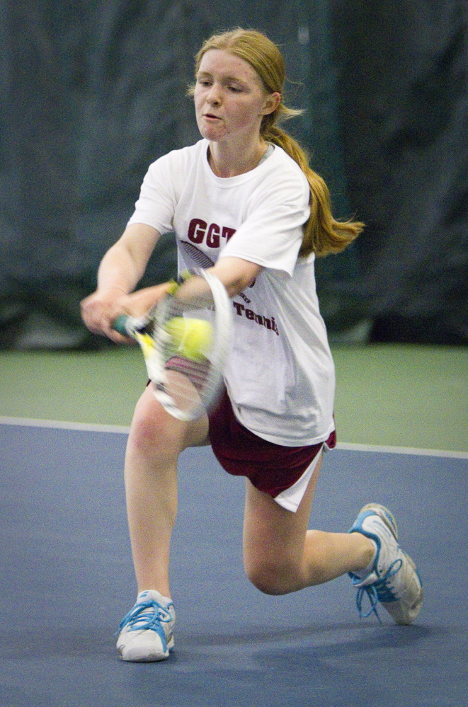 Katherine Pares of Greely returns a shot to Colleen O'Donnell of Camden Hills during their singles match in the Class B state final.