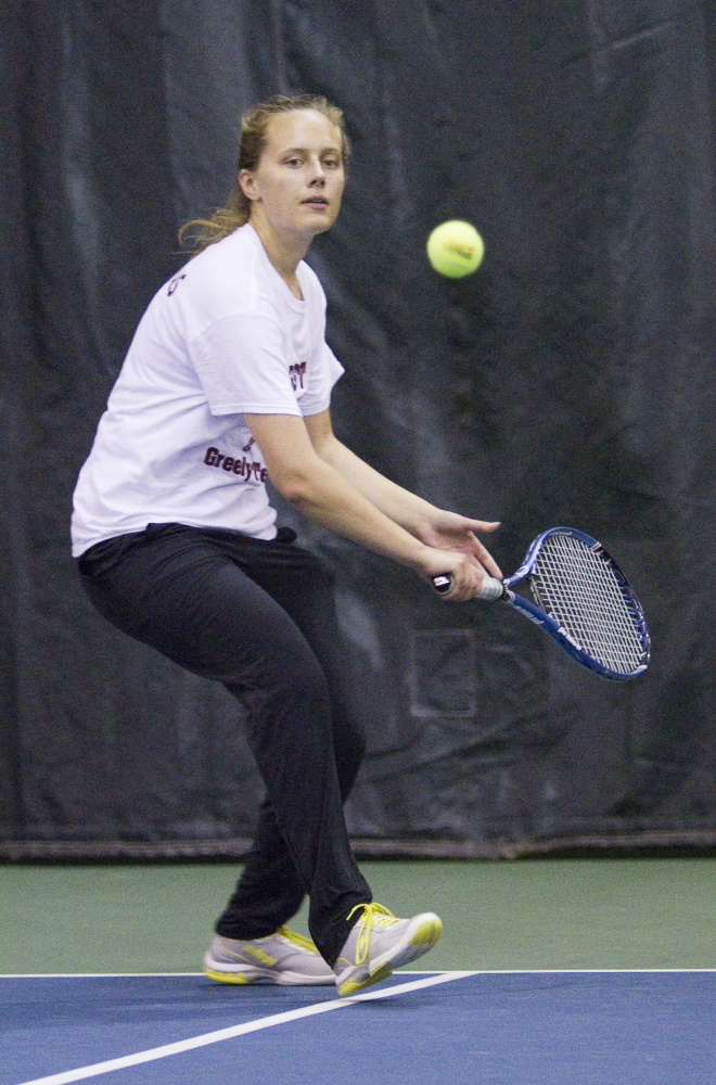 Anna Collins of Greely returns a volley to Emily Dufour of Waterville during their singles match Saturday in the Class B finals. Collins rallied to a three-set victory.