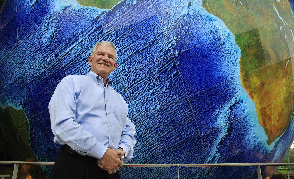 """DeLorme Publishing CEO Michael Heffron, standing near the giant revolving Earth in the window of its Yarmouth headquarters, says """"we're going to protect our reputation"""" in the patent case appeal."""