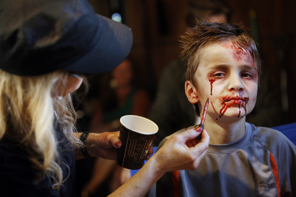"""Derek Davis/Staff Photographer Ozric Stewart, 7, of Yarmouth gets his hair and makeup done Monday before his scene in """"Night of the Living Deb."""""""