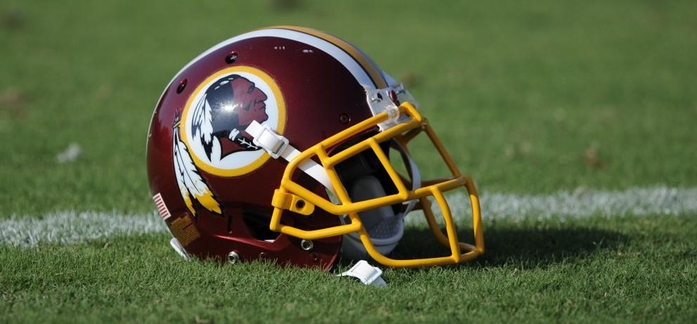 A Washington Redskins football helmet lies on the field during NFL football minicamp, Wednesday.