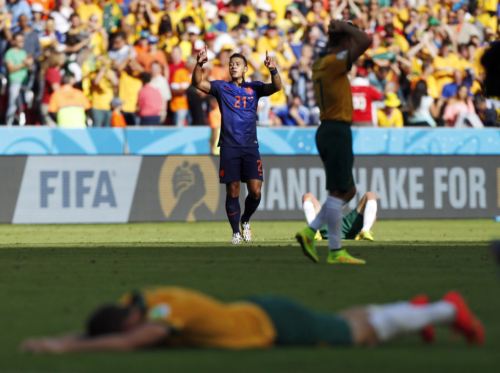 Netherlands' Memphis Depay celebrates his team's 3-2 victory over Australia during the group B World Cup soccer match between Australia and the Netherlands at the Estadio Beira-Rio in Porto Alegre, Brazil, Wednesday, June 18, 2014.  (AP Photo/Jon Super)
