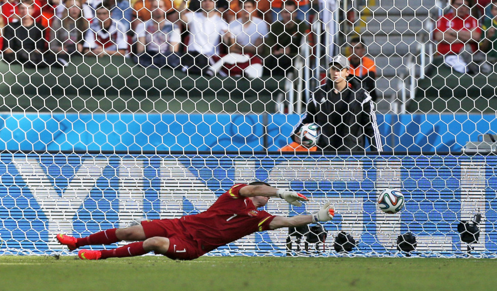 Australia's goalkeeper Mat Ryan fails to stop a shot by Netherlands' Robin van Persie to score his side's second goal during the group B World Cup soccer match between Australia and the Netherlands at the Estadio Beira-Rio in Porto Alegre, Brazil, Wednesday, June 18, 2014.  (AP Photo/Jon Super)