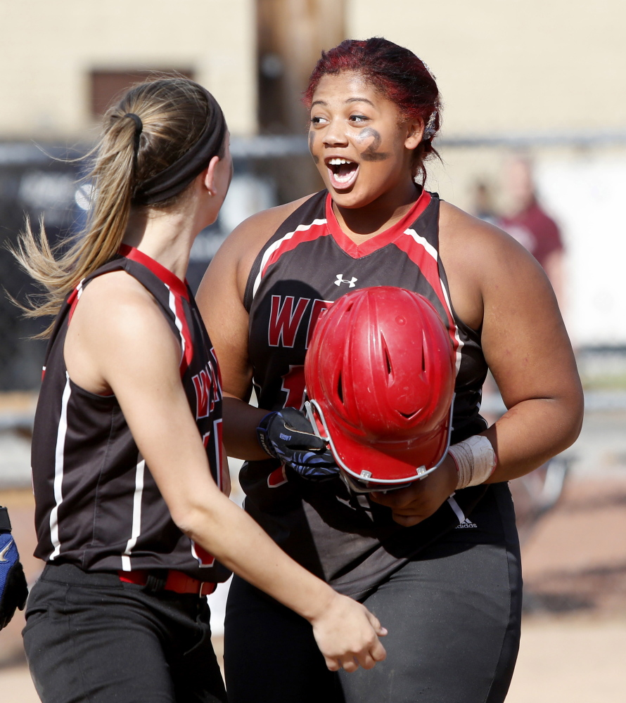 Wells High School's Jordan Agger celebrates after hitting her third home run against Cape Elizabeth High School during their Western Class B championship softball game at Saint Joseph's College in Standish on Wednesday.