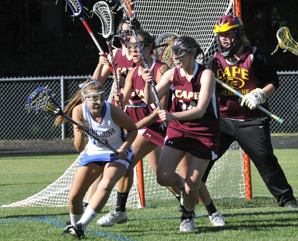 Kennebunk's Haley Fecko looks for running room as Cape Elizabeth defenders converge to protect the goal. Cape Elizabeth will play Yarmouth at 10 a.m. Saturday for the state title.
