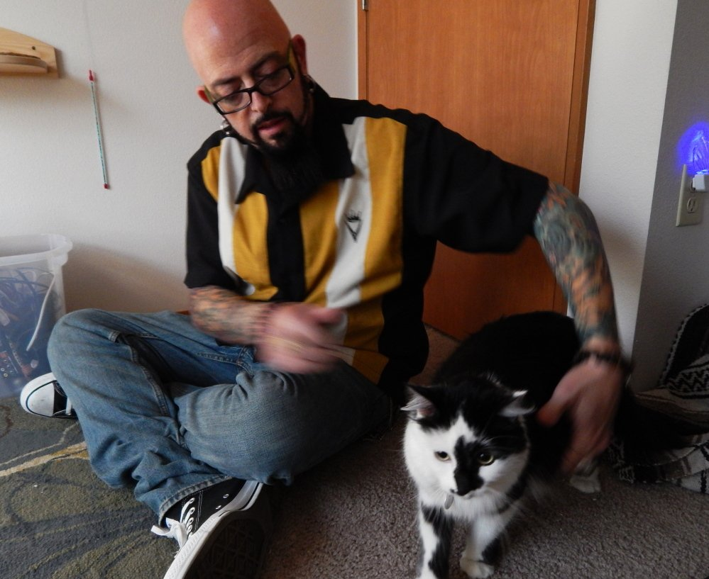 """Jackson Galaxy, host of Animal Planet's """"My Cat From Hell,"""" sits in Portland, Ore., with a cat named Lux, whose owners called 911 after Lux boxed them into a bedroom."""
