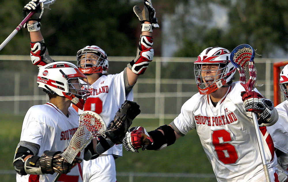 South Portland's Duncan Preston, 6, celebrates after scoring the winning goal with 1.9 seconds left in Wednesday's Western Class A boys' lacrosse final in South Portland. The Red Riots scored three times in the final minute.