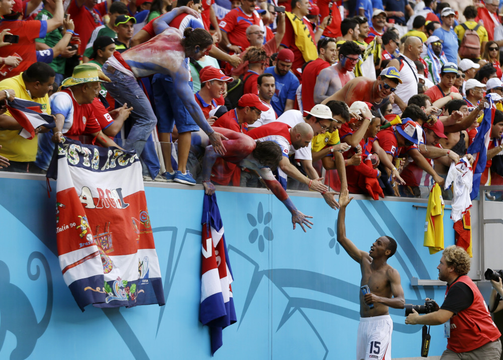 Costa Rica's Junior Diaz celebrates with fans following the team's 1-0 victory over Italy during the group D World Cup soccer match between Italy and Costa Rica at the Arena Pernambuco in Recife, Brazil, on Friday.