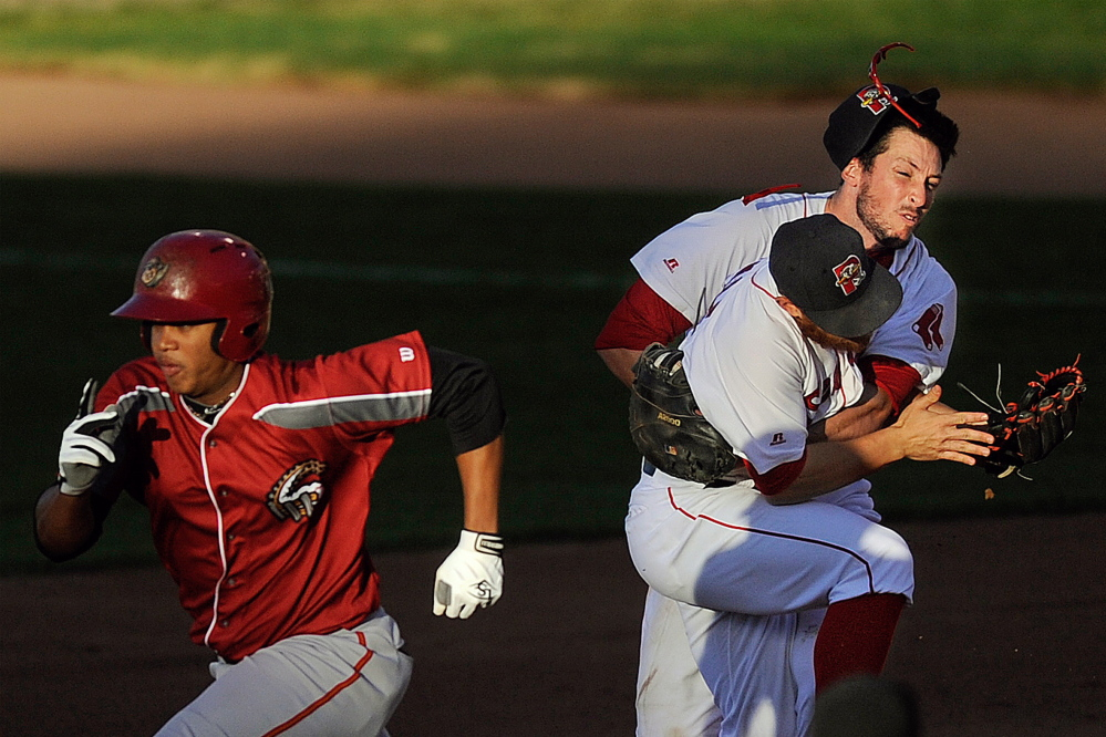 Altoona Curve baserunner Willy Garcia makes his way toward second as Sea Dogs second baseman Sean Coyle, center, and first baseman Stefan Welch, right, collide while pursuing a ground ball with one out in the seventh inning at Hadlock Field on Friday. Gabe Souza/Staff Photographer