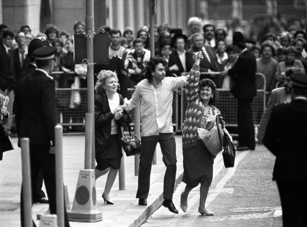 In this 1989 file photo, Gerry Conlon, center, is seen outside the Old Bailey after being released for being wrongly convicted of the Guilford pub bombings, in London. His family says Gerry Conlon, who was imprisoned unjustly for an IRA bombing and inspired an Oscar-nominated film, has died at his Belfast home following a long battle with cancer. He was 60.