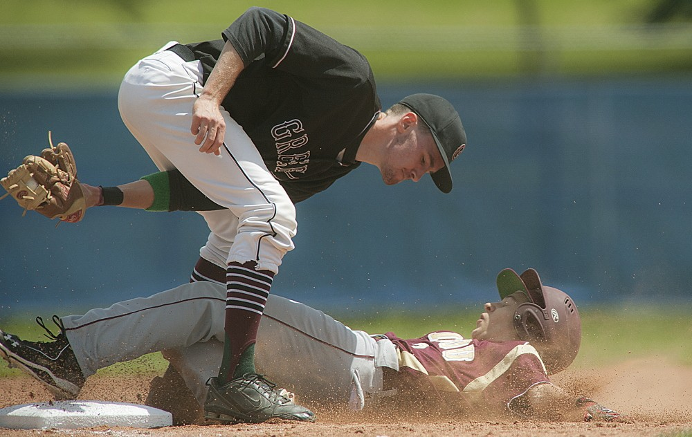 Greely third baseman Sam Porter tags out Caribou's Connor Thibeault for an out in the first inning of Saturday's state Class B championship game at Mansfield Stadium in Bangor. Greely won, 1-0.