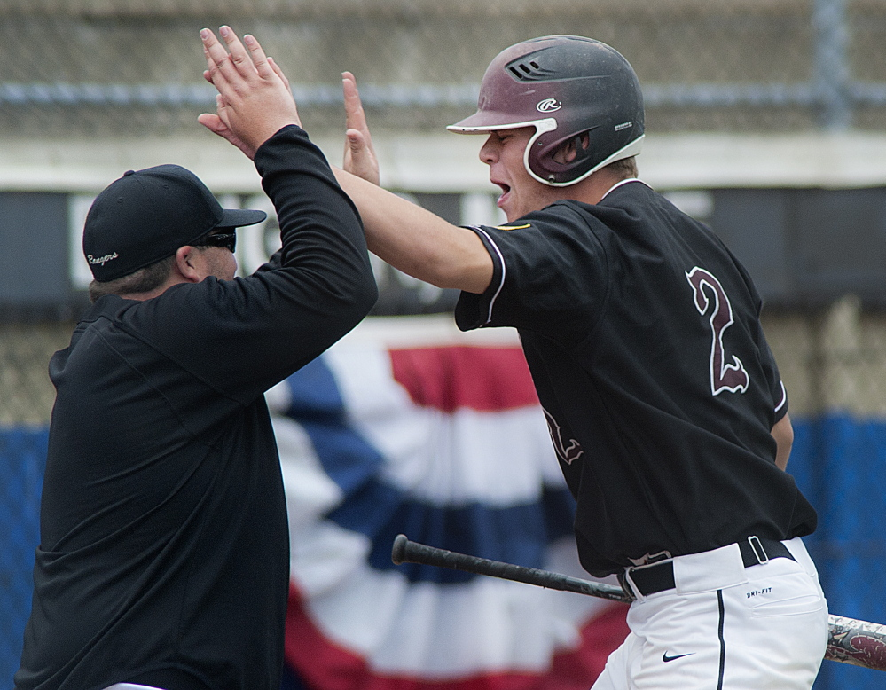 Greely pinch-hitter Will Bryant is congratulated after scoring the winning run in the seventh inning.