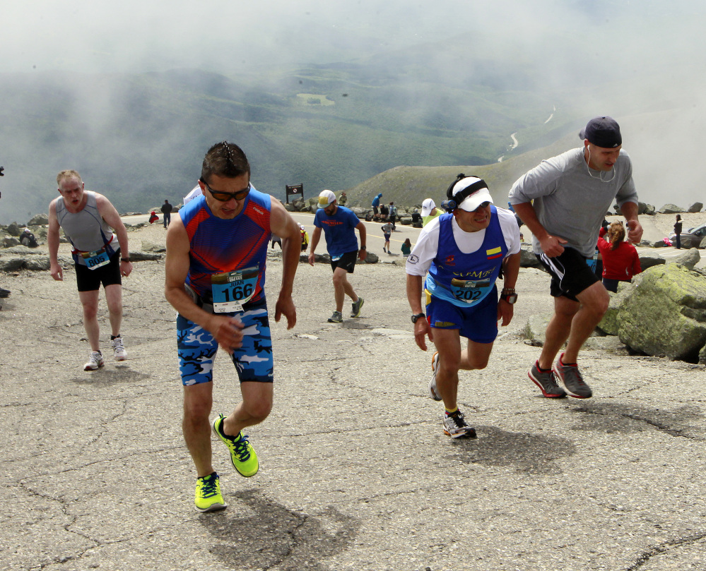 Runners struggle to make it to the top up the Mount Washington Auto Road during the  Northeast Delta Dental Mt. Washington Road Race, on Saturday. More than 1,000 runners raced 7.6 miles to the highest peak in the Northeast of 6,288 feet