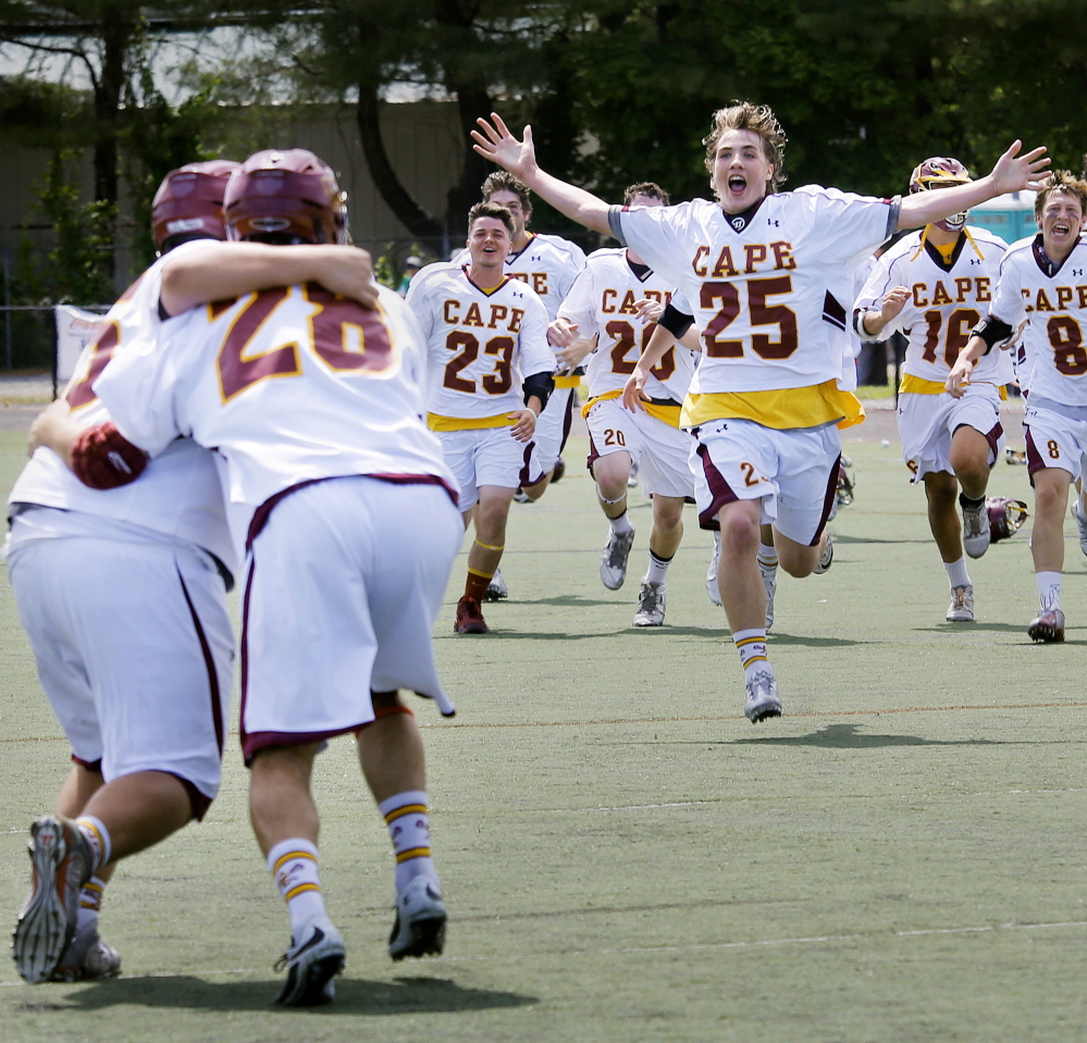 Owen Thoreck (25) and his Cape Elizabeth teammates begin their celebration after defeating Yarmouth 6-3 in the Class B boys' lacrosse state championship game Saturday at Fitzpatrick Stadium.