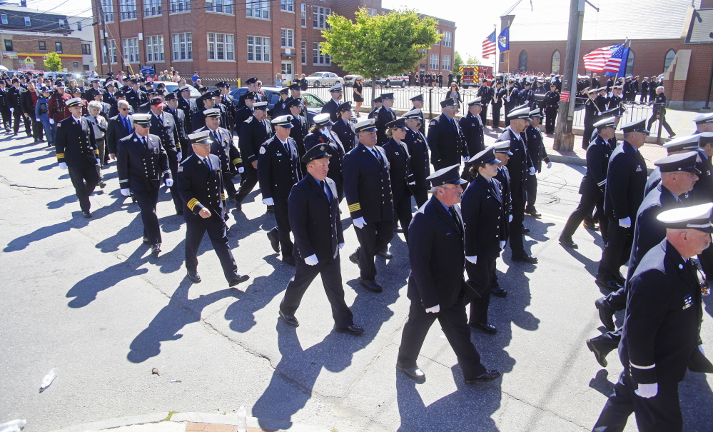 Firefighters from near and far march into the funeral service for Portland Fire Capt. Michael Kucsma at the Cathedral of the Immaculate Conception in Portland Saturday, June 21, 2014. Jill Brady/Staff Photographer