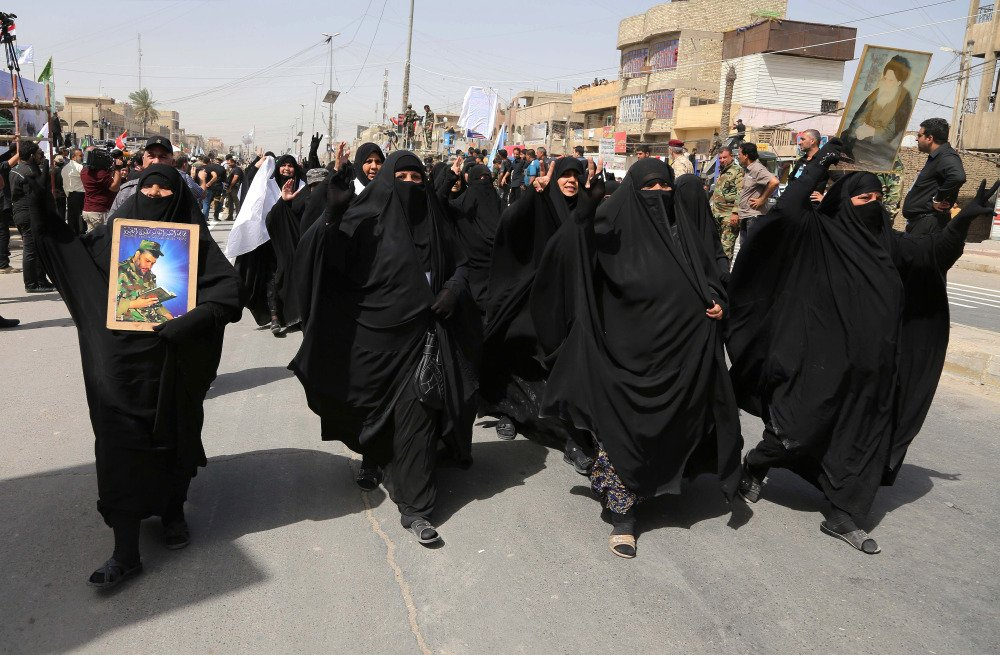 """Supporters for the newly formed """"Peace Brigades"""" participate in a parade in the Shiite stronghold of Sadr City, Baghdad, Iraq, Saturday."""