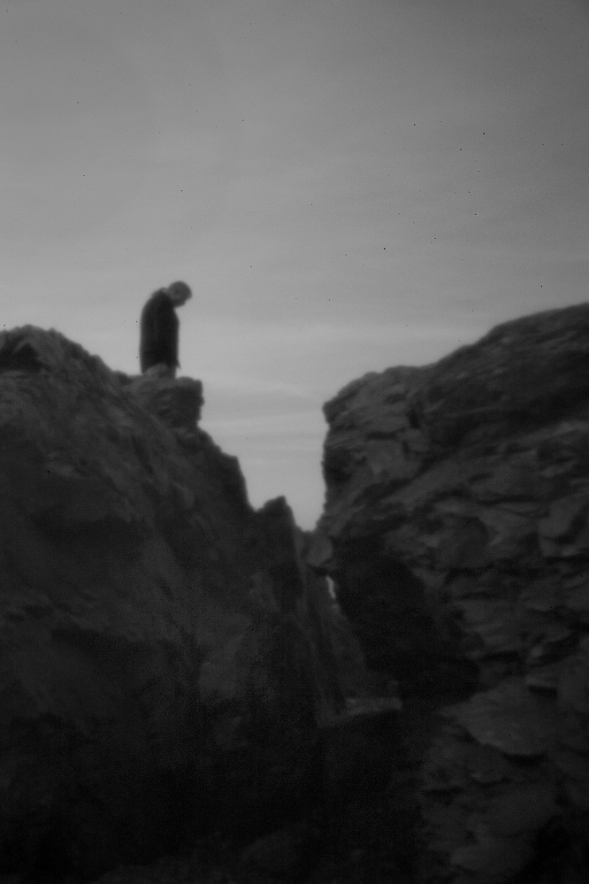 A member of the tribe, Allen Sockabasin, as seen through the aperture of a pinhole camera, stands on Split Rock at the Pleasant Point Indian Reservation on April 30. Split Rock is of great spiritual significance to the Passamaquoddy, a tribe with two reservations in Washington County, Maine. Read more about the camera, PAGE AX
