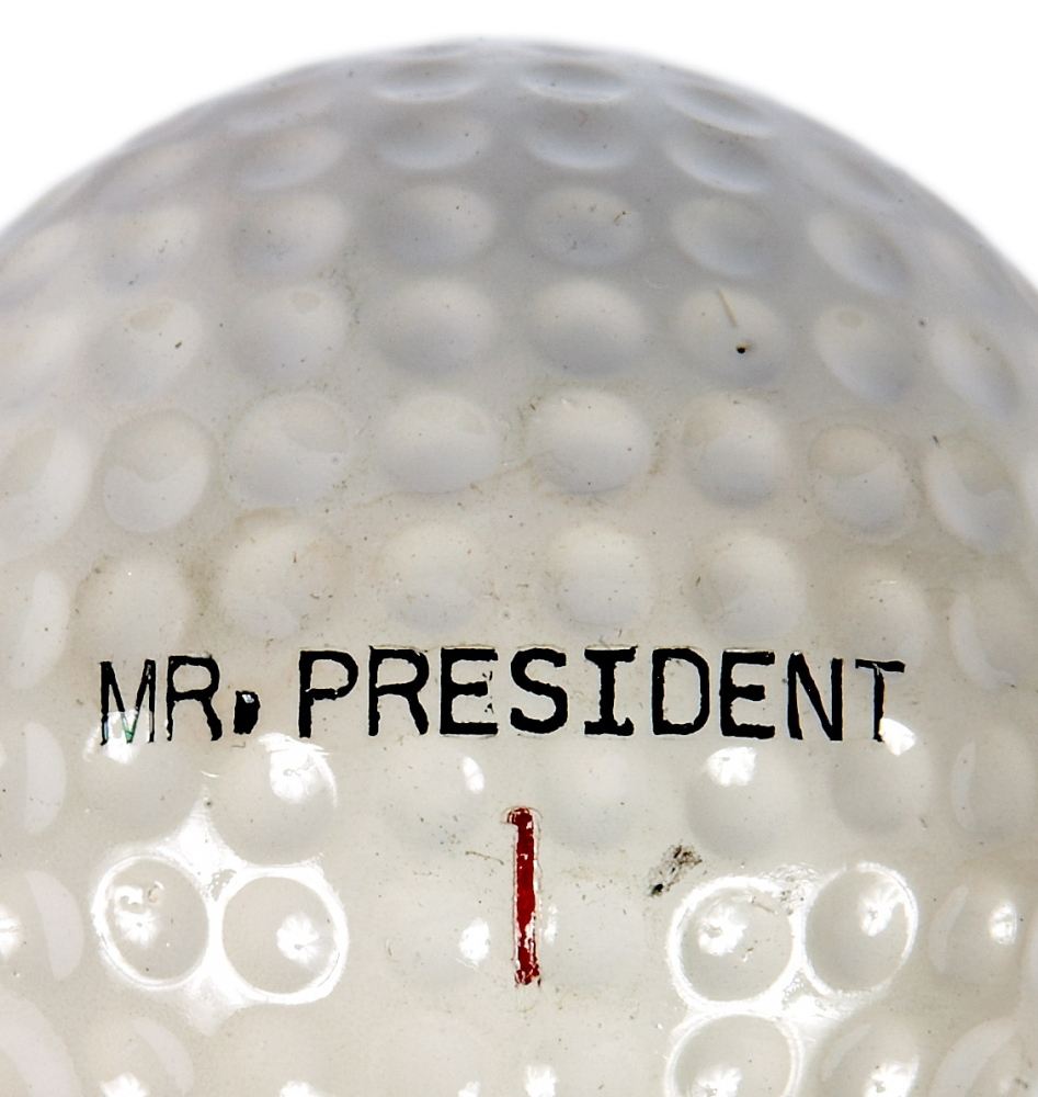 """A golf club, golf cart and a set of personalized """"Mr. President"""" golf balls are on display at the museum."""