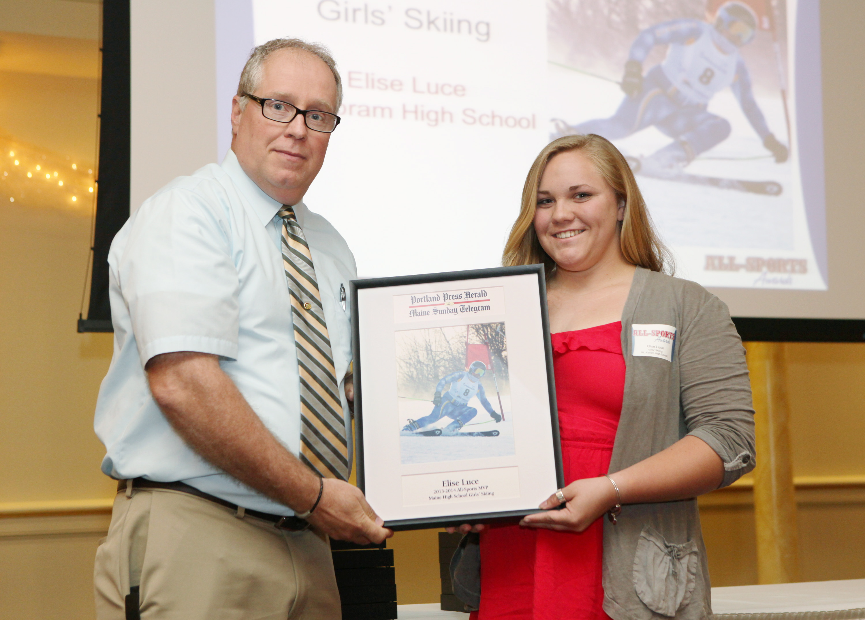 Elise Luce of Mt. Abram High School receives an award for skiing from Press Herald sports writer Mike Lowe during the 27th Annual All-Sports Awards Sunday.  Joel Page/Staff Photographer
