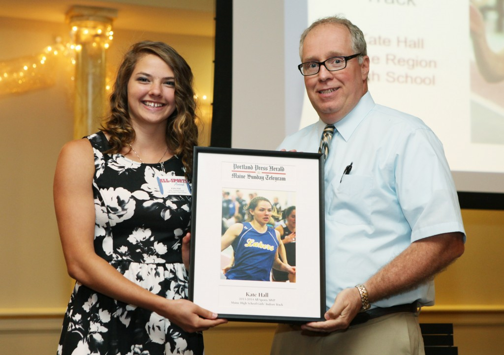 Kate Hall of Lake Region High School receives an award for Girl's Indoor Track from Press Herald sports writer Mike Lowe during the 27th Annual All-Sports Awards Sunday. Joel Page/Staff Photographer