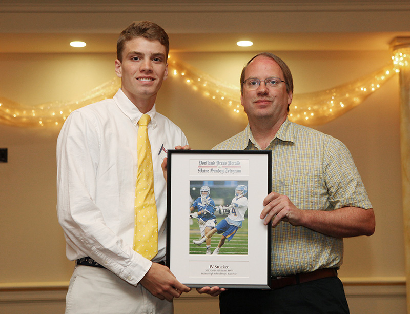 IV Stucker, of Falmouth High School receives an award for Boy's Lacrosse from Press Herald sports writer Mark Emmert during the 27th Annual All-Sports Awards Sunday. Joel Page/Staff Photographer