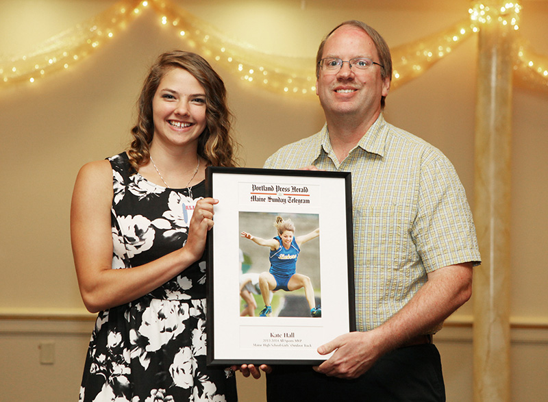 Kate Hall, of Lake Regin High School receives an award for Girl's Outdoor Track from Press Herald sports writer Mark Emmert during the 27th Annual All-Sports Awards Sunday. Kate Hall, of Lake Regin High School receives an award for Girl's Outdoor Track from Press Herald sports writer Mark Emmert during the 27th Annual All-Sports Awards Sunday. Joel Page/Staff Photographer