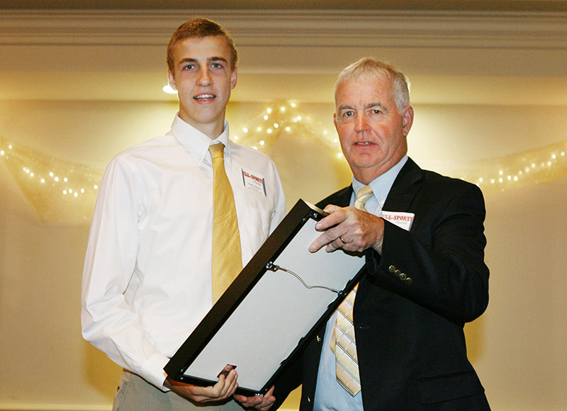 Wyatt Omsberg, of Scarborough High School receives an award for Boy's Soccer from Press Herald sports writer Tom Chard during the 27th Annual All-Sports Awards Sunday. Joel Page/Staff Photographer