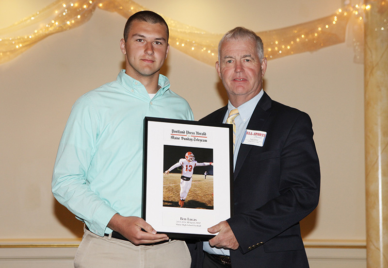Ben Lucas, of Cony High School receives an award for Boy's Cross Country from Press Herald sports writer Tom Chard during the 27th Annual All-Sports Awards Sunday. Joel Page/Staff Photographer