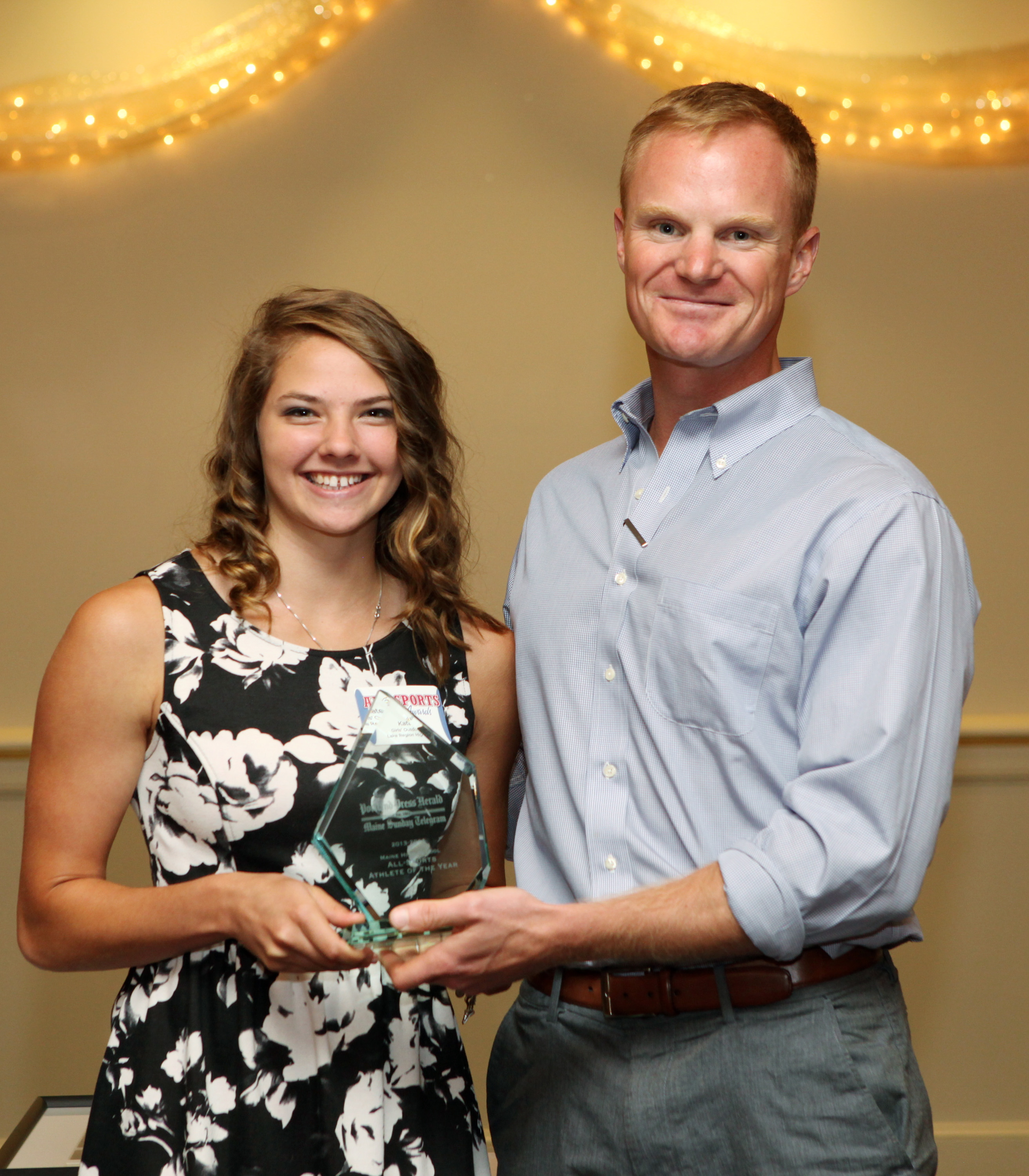 Athlete of the Year Kate Hall of Lake Region High School poses with former major league baseball player Simon Williams during at the 27th Annual All-Sports Awards ceremony Sunday. Joel Page/Staff Photographer