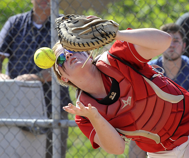 Scarborough's catcher Megan Murrell can't handle a pop up as Scarborough HS softball plays Thornton Academy for the Western Class A Softball Championship at St. Joseph's College in Standish.