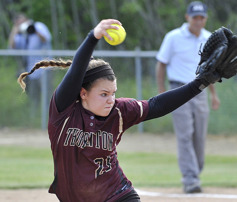 TA's #21 Bailey Tremblay delivers a pitch as Scarborough HS softball plays Thornton Academy for the Western Class A Softball Championship at St. Joseph's College in Standish.