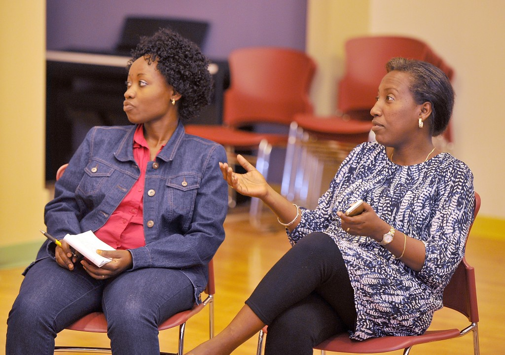 Ridelphine Katabesha, left, who immigrated from the Democratic Republic of the Congo, listens as Mia Ntahobari from Burundi communicates with other members of a women's group meeting. They both expressed their concern for their family, friends and the immigrant community with Gov. LePage's edict to withhold funding for General Assistance for  undocumented immigrants.