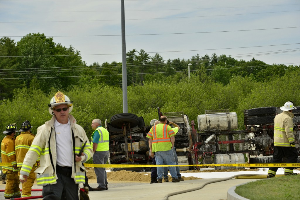 A tractor-trailer truck carrying fuel that overturned on northbound Route 114 in Gorham on Wednesday was expected to disrupt traffic through the evening commute.