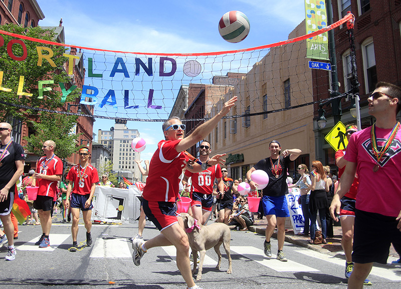 Alex Beal of Portland keeps the ball in the air with Get Out Portland Volleyball members marching in the Portland Pride Parade on Congress Street in Portland Saturday. Jill Brady/Staff Photographer
