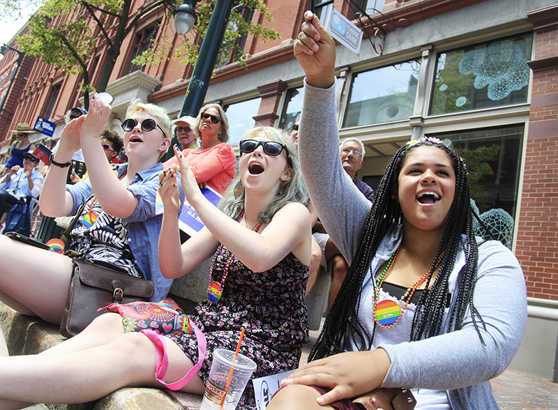 Taking in the excitement of the Portland Pride Parade are, from right, Hannah Austin, and Isla and Terra Brazier, all of Bath, along Congress Street in Portland Saturday. Jill Brady/Staff Photographer